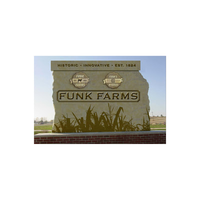 Funk Farms headquarters sign, carved and painted onto rock